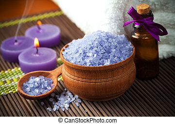 Spa and wellness setting with candles and towel - lavender...