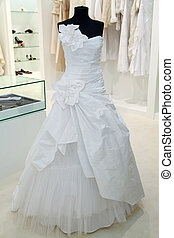 Wedding dress on a mannequin in a bridal shop