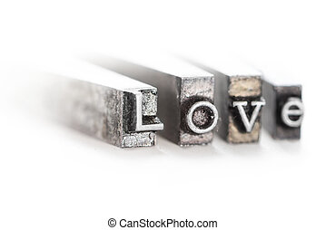 "The word ""love"" in letterpress type on withe background -..."