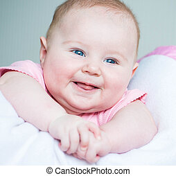 three month old baby smiles close-up