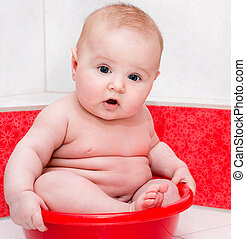 baby having bath - Cute baby having bath in a tub
