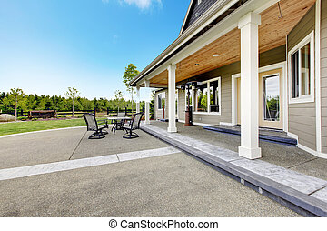 Large farm country house with long covered porch.