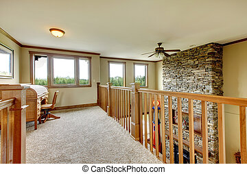 House hallway with stone fireplace and wood railing. - House...