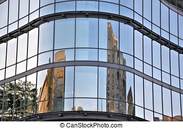 glass facade - Houses are reflected in a glass facade