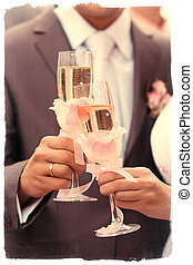 Newlyweds toasting with champagne - Happy young family...