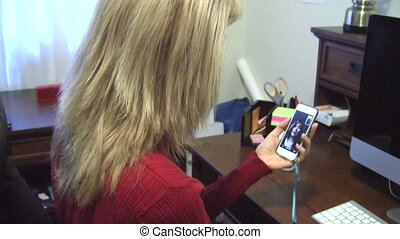 Woman answering video chat call