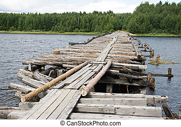 Broken bridge - An old broken bridge on a river in Karelia,...