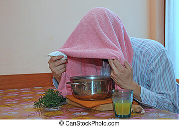 man with pink towel breathe balsam vapors to treat colds and...