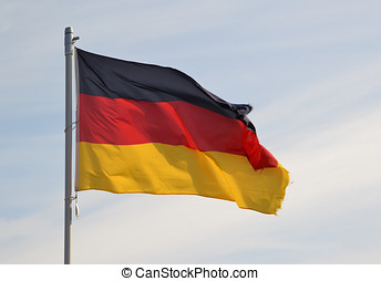 a Germany flag waving in the wind on a pole