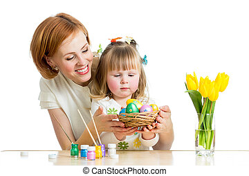 mother and baby kid painting easter eggs