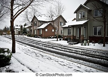 Snow covered street and homes - After a night of heavy snow,...