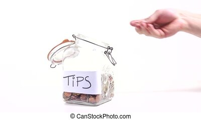 Tips - Person putting money in a jar for tips