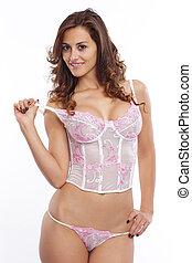 Brunette beauty posing in pink