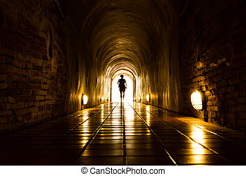 Light and human at End of Tunnel - silhouette of human in...