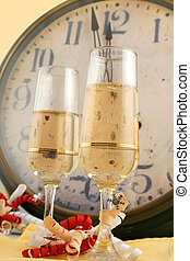 new year\\\'s countdown - champagne in glasses with ribbons...