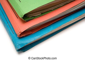 Colorful Binders - Stacked colored binders isolated on a...