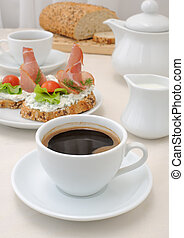 Appetizer with ham and ricotta - breakfast with a cup of...