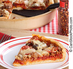 Slice of Deep Dish Pizza - Slice of deep dish pizza with...