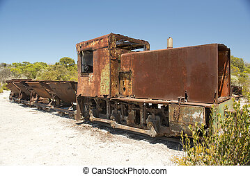 Rusty Train - Rusted old mining train and its carriages