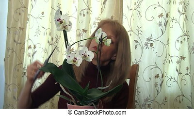 Woman trimming orchid