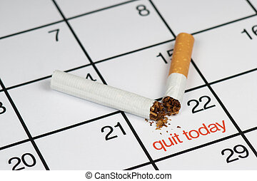 Quit smoking today - A broken cigarette above a calendar,...