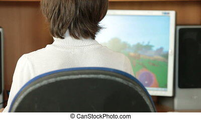 Desktop Computer Gaming - Boy Playing Desktop Computer Games...