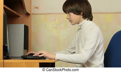 Child Using Desktop Computer - Teen boy using desktop...