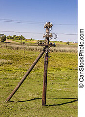 Old wooden electric pylon.