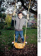 Swinging - Little boy swinging