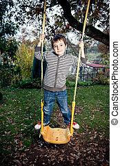 Swinging - Little boy swinging