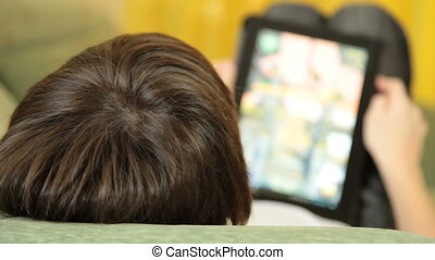 Child Using  Touch Screen Tablet PC