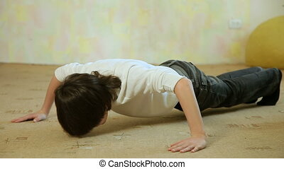 Child Doing Push-Ups - Teen boy takes a break in learning,...