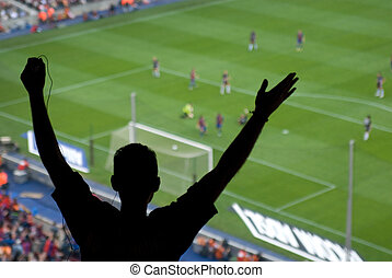 A soccer fan cheering for a goal in Spain