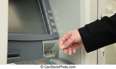 Withdrawing Money From ATM Machine - Businesswoman...