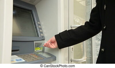 Woman Taking Money From ATM Machine - Woman Using Credit...