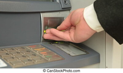 Businessman Using ATM Machine - Businessman Checking Account...