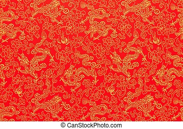 Fragment of red chinese silk with golden dragons and flowers...