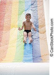 Boy at aqua park - Happy little boy in pool at aqua park