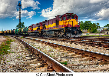 Long freight train on slide rails at cloudy day