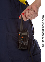Woman hand take off cb radio from pocket