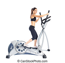 Pretty brunette doing exercises on gym equipment, isolated...