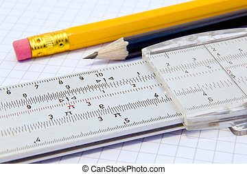 Slide rule and pencils