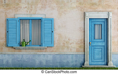 facade of an old house - detail of an old house with blue...