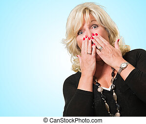 Scared Woman Covering Her Mouth against a blue background
