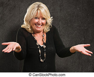 Happy Woman Gesturing against a grunge background