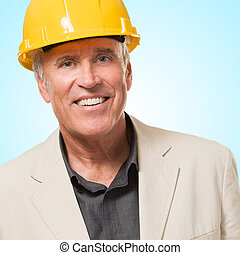 Happy Architect Man Smiling against a blue background