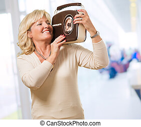 Woman Listening To Music With A Vintage Radio, indoor