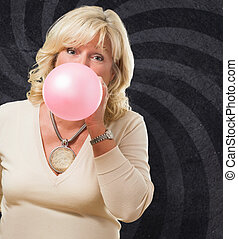 Woman Blowing Bubble Gum against a spiral background