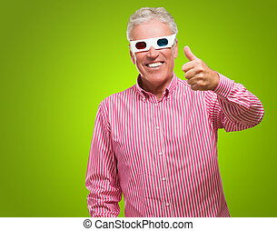 Man Appreciating 3d Movie against a green background