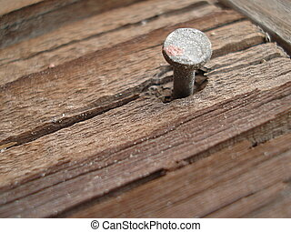 Old Nail in Board - An old nail sticks up from a weathered...